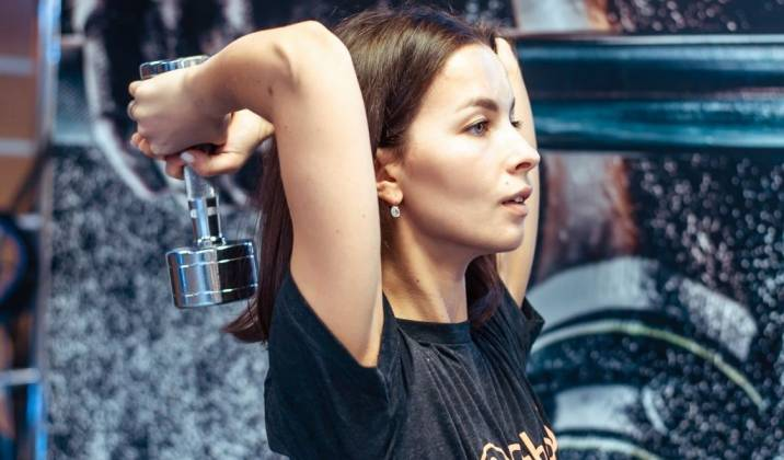overhead tricep extension - upper body dumbbell exercises for weight loss