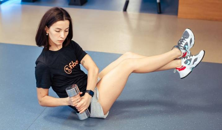 weighted russian twist - dumbbell ab exercises for weight loss