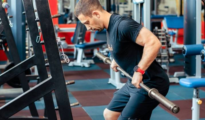 bent over row is a premiere back strengthening exercise that can be done with a barbell, dumbbells and kettlebells