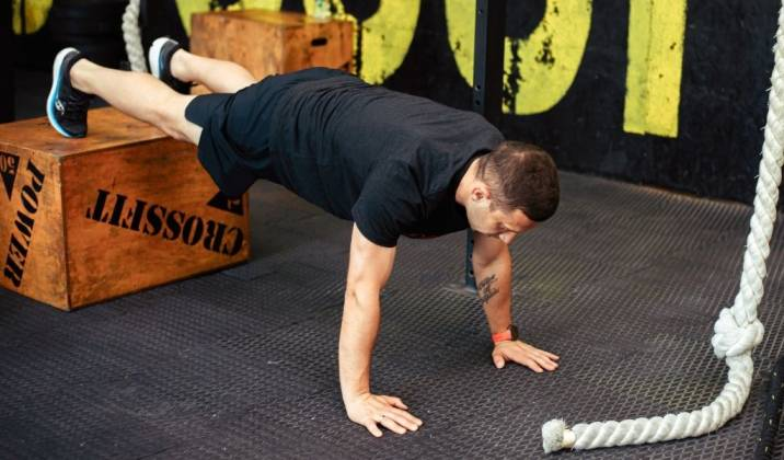 doing push ups on a deficit you increase the range of motion and can increase muscle damage and growth