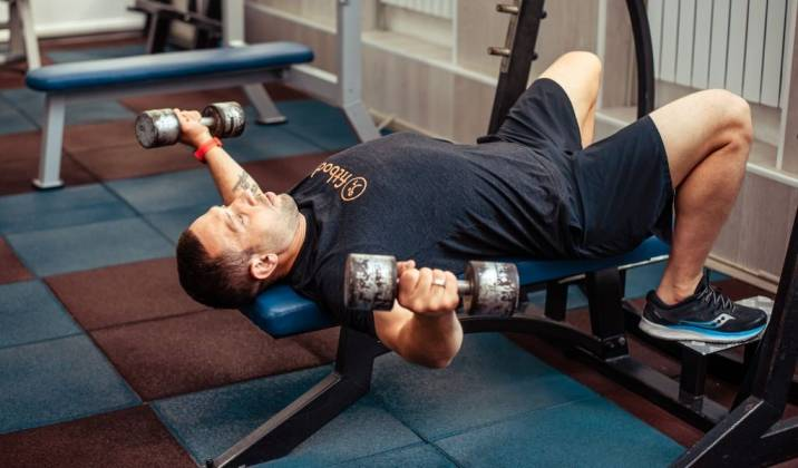 the dumbbell fly is an isolation chest exercise that can be done from a flat or incline bench position